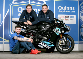 PACEMAKER, BELFAST, 19/12/2017: Adam McLean pictured with the new IMRacing/Quinns Printers S1000RR BMW he will race on the roads in 2018. Looking on are team sponsor Peter Bradley, MD of quinnstheprinters.com with Ian Moffit, team principal of IMRacing.  Adam will race the BMW in the Superbike and Superstock classes alongside a Yamaha YZF-R6 in the Supersport races. The team having recently purchased a 600cc machine from Raceways Motorcycles.  For more information go to @IMRacingTeam, quinnstheprinters.com, @islandskypr.  PICTURE BY STEPHEN DAVISON
